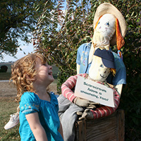 girl and scarecrow